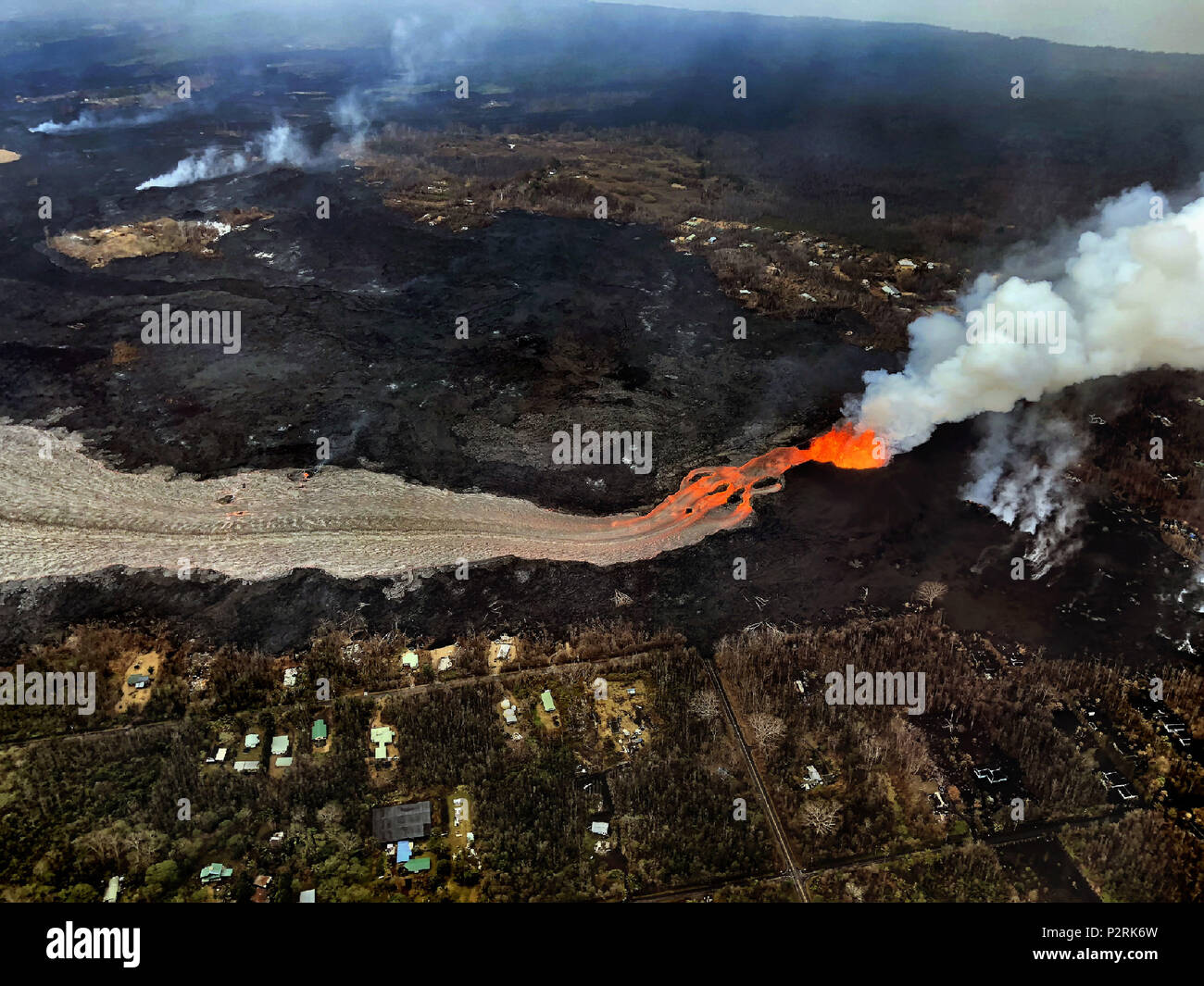 Pahoa, Hawaii, USA. 10th June, 2018. The Kilauea Volcano east rift zone eruption continues as seen from the air mainly from Fissure 8 and forms a river of lava flowing down from Leilani Estates to Kapoho on Sunday. Credit: L.E. Baskow/ZUMA Wire/Alamy Live News - Stock Image