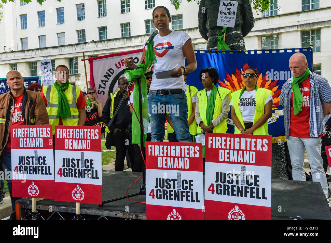 London, UK. 16th June 2018. London Firefighter Lucy Masoud, one of the first to arrive at Grenfell Tower, speaks to the large crowd at Downing St  in solidarity with the 72 killed and the survivors of the Grenfell fire a year ago at a protest organised by Justice4Grenfell and the FBU (Fire Brigades Union.) After some speeches they marched to the Home Office for a brief protest before returning to Downing St for more speeches. Speakers complained of the many promises made by Theresa May which have been broken, despite her promise all survivors would be rehoused in 3 weeks, a year later 50% of s - Stock Image