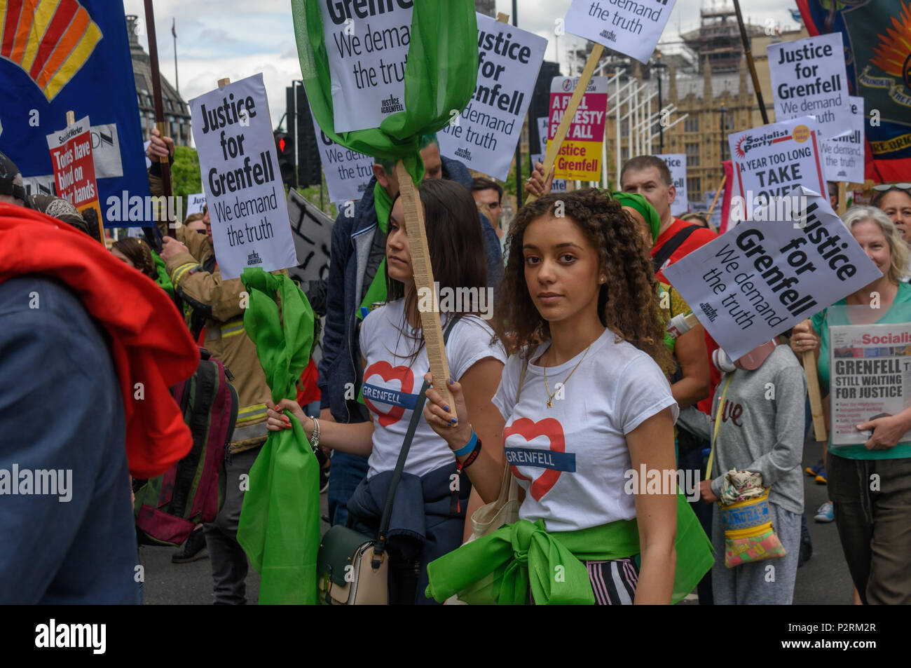 London, UK. 16th June 2018. A large crowd marches from Downing St to the Home Office in solidarity with the 72 killed and the survivors of the Grenfell fire a year ago at a protest organised by Justice4Grenfell and the FBU (Fire Brigades Union.) After some speeches they marched to the Home Office for a brief protest before returning to Downing St for more speeches. mmo Credit: Peter Marshall/Alamy Live News - Stock Image