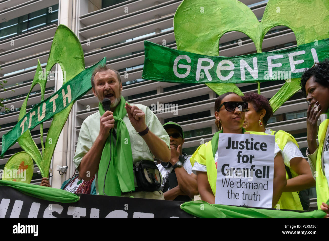 London, UK. 16th June 2018. NEU General Secretary Kevin Courtney speaks at the Home Office in solidarity with the 72 killed and the survivors of the Grenfell fire a year ago at a protest organised by Justice4Grenfell and the FBU (Fire Brigades Union.) After some speeches they marched to the Home Office for a brief protest before returning to Downing St for more speeches. Speakers complained of the many promises made by Theresa May which have been broken, despite her promise all survivors would be rehoused in 3 weeks, a year later 50% of survivors and displaced families are still in emergency a - Stock Image