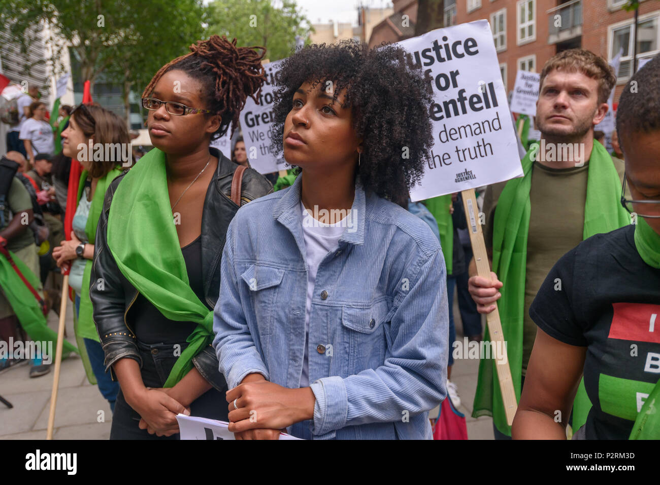 London, UK. 16th June 2018. A large crowd at the Home Office shows solidarity with the 72 killed and the survivors of the Grenfell fire a year ago at a protest organised by Justice4Grenfell and the FBU (Fire Brigades Union.) After some speeches they marched to the Home Office for a brief protest before returning to Downing St for more speeches. mmodation. 300 tower blo Credit: Peter Marshall/Alamy Live News - Stock Image