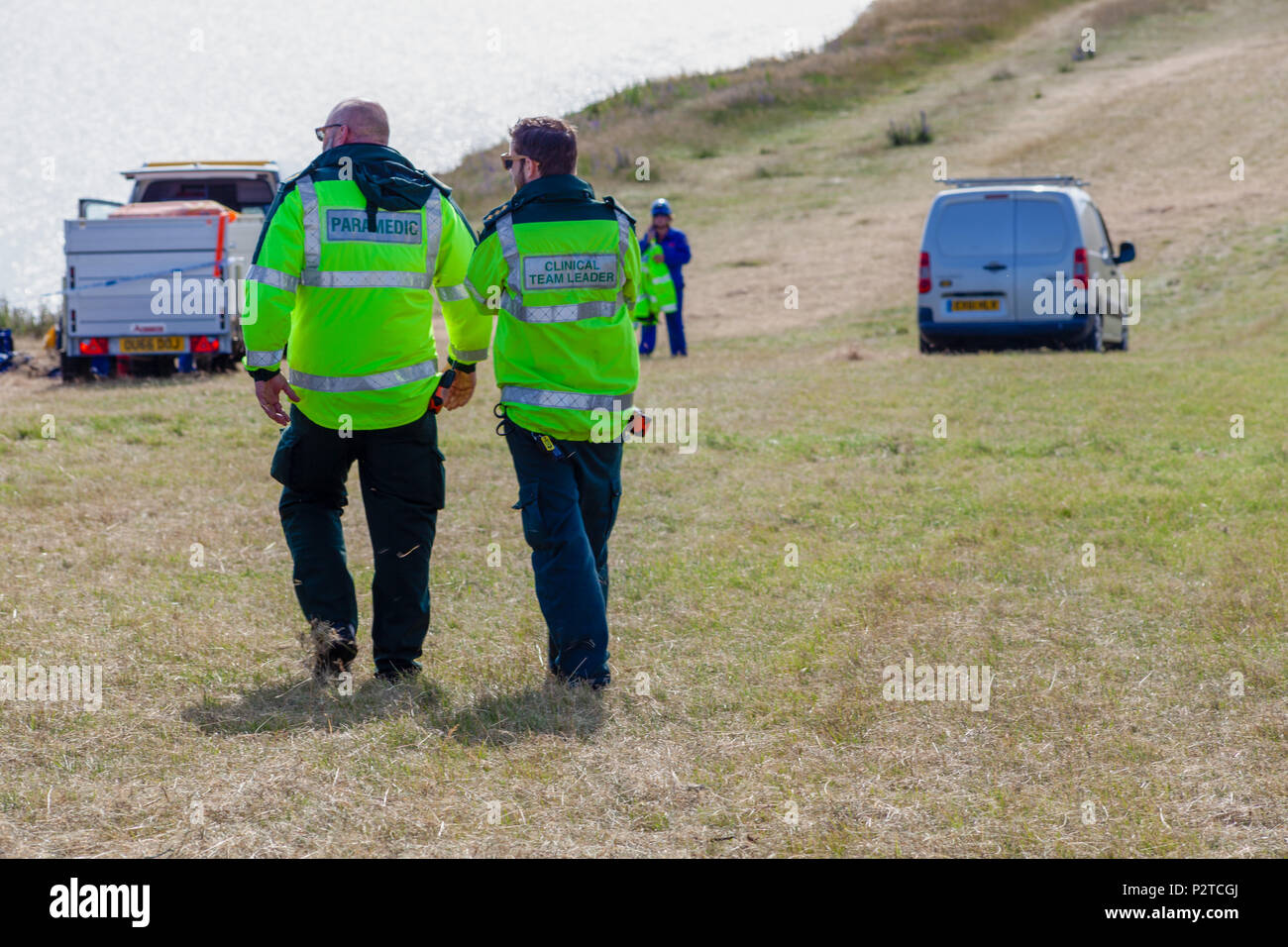 Beachy Head Sussex UK June13th 2018; Paramedics arrive on scene to assist HM Coastguard at Beachy Head in Sussex - Stock Image