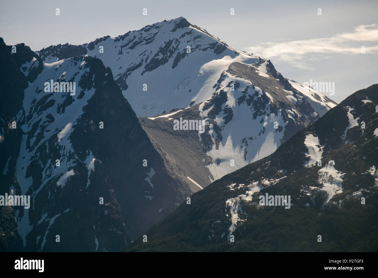 This is a close view on one of the Martial mountains that surround the Argentinian city of Ushuaia. Winter is coming and snow has fallen. - Stock Image