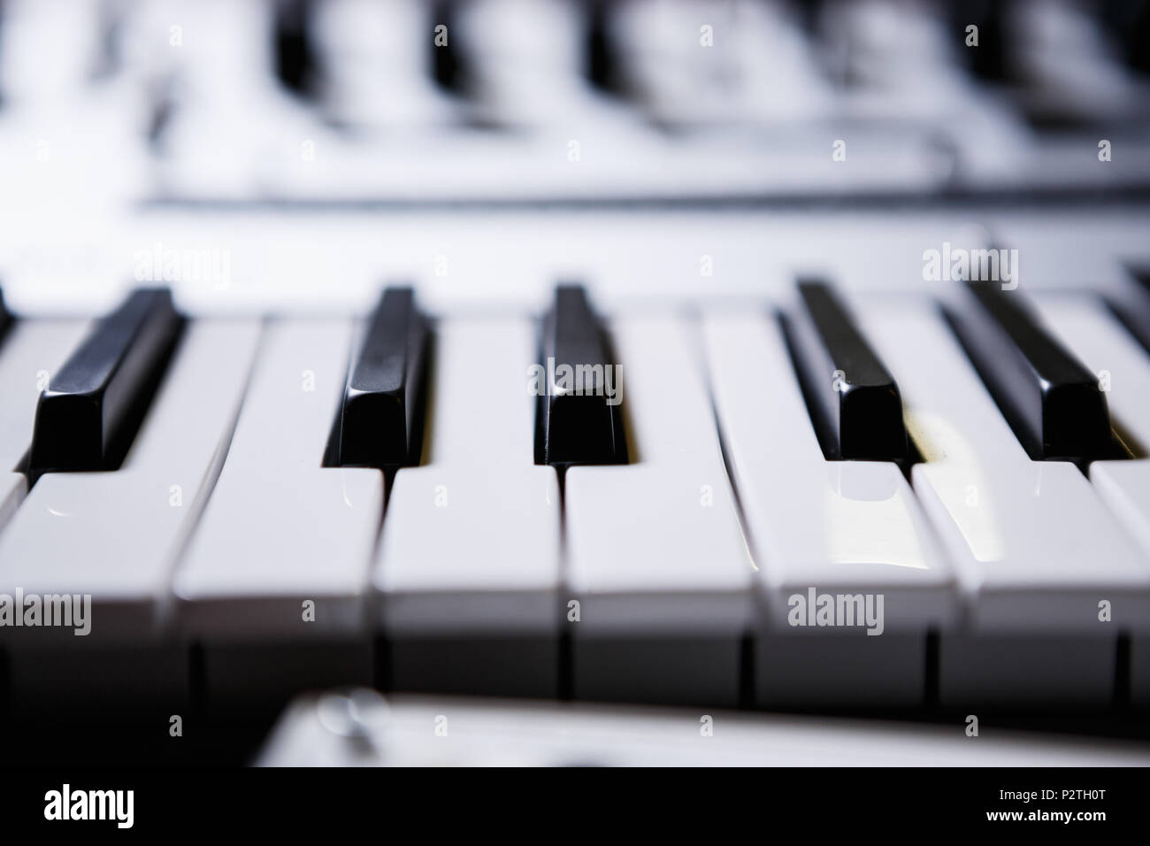 Synthesizer black and white piano keys.Professional electronic midi keyboard.Audio equipment for music production.Sound recording studio device for mu - Stock Image