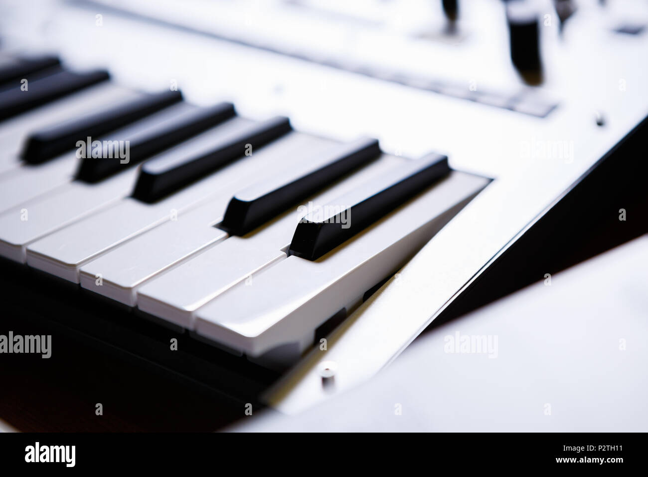 Synthesizer key board in close up.Audio equipment for music production.Sound recording studio device for musician & composer.Professional electronic m - Stock Image