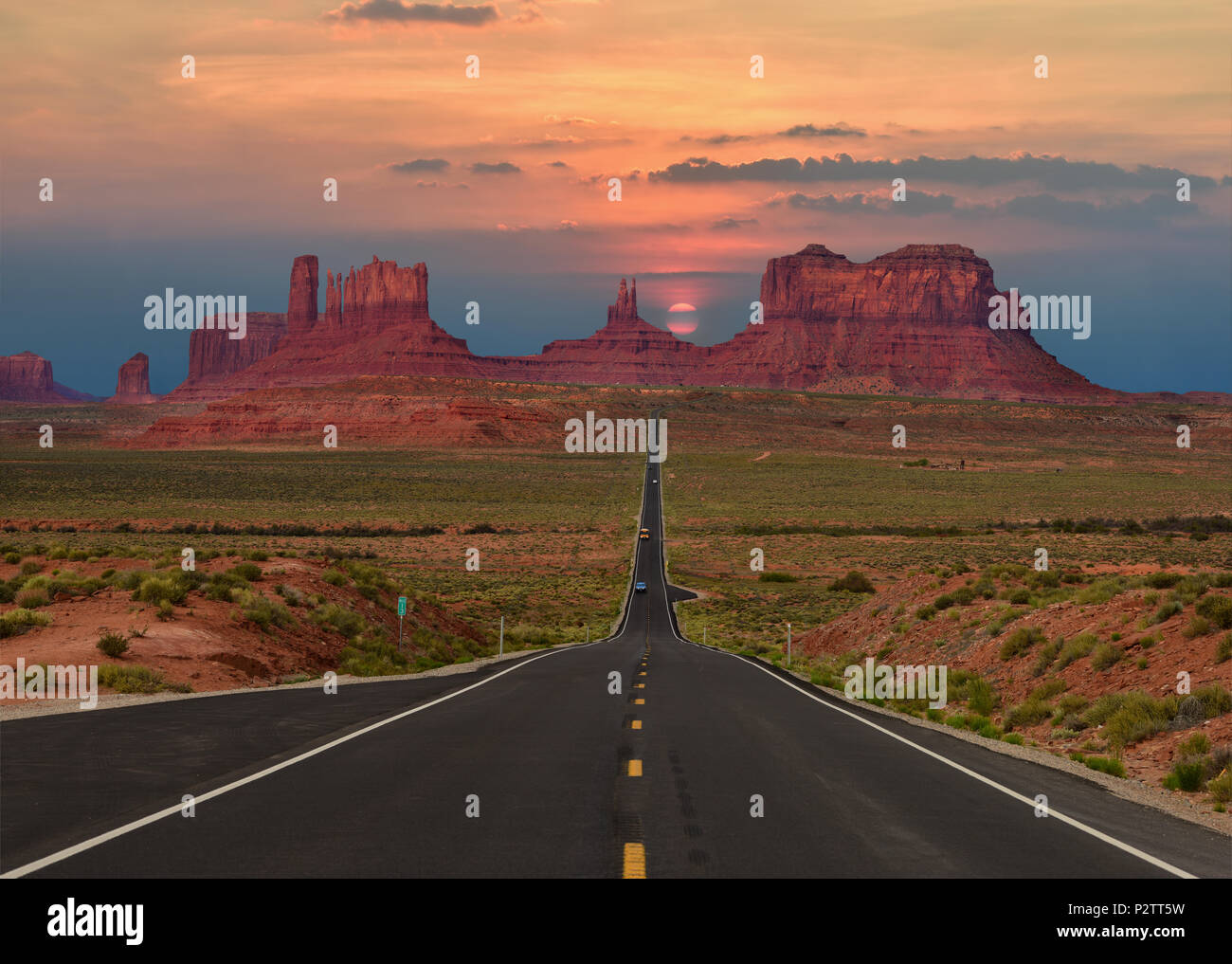 Scenic highway in Monument Valley Tribal Park in Arizona-Utah border, U.S.A. at sunset. - Stock Image
