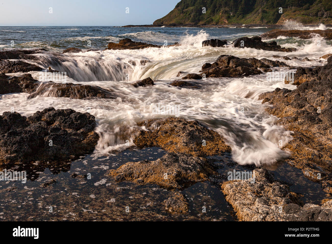 Water is drawn into Thor's Well at Cape Perpetua Scenic Area along Oregon's Central Coast south of Yachats. - Stock Image