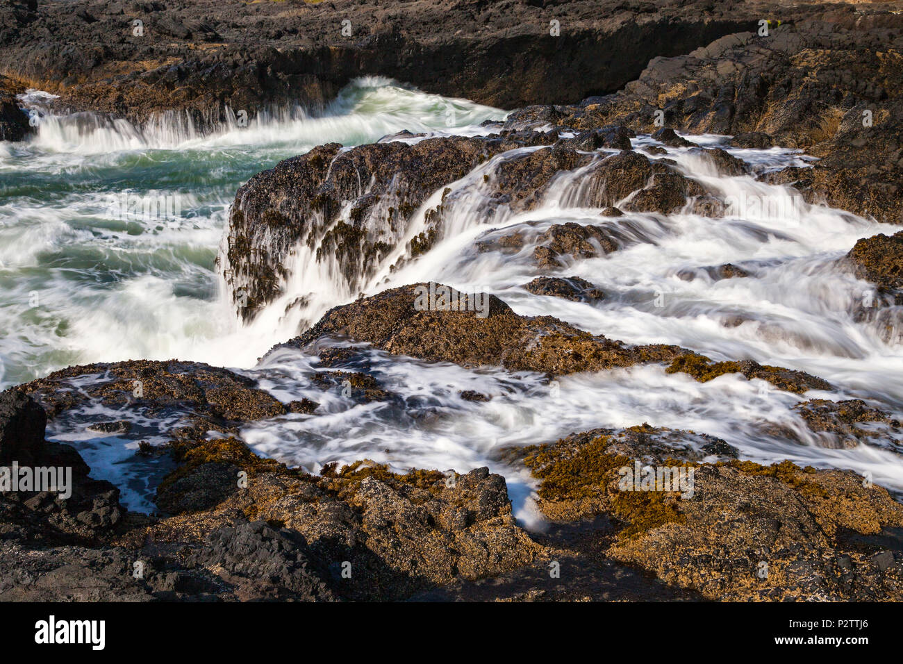 Water surges from tidal action at Cape Perpetua Scenic Area along Oregon's Central Coast south of Yachats. - Stock Image