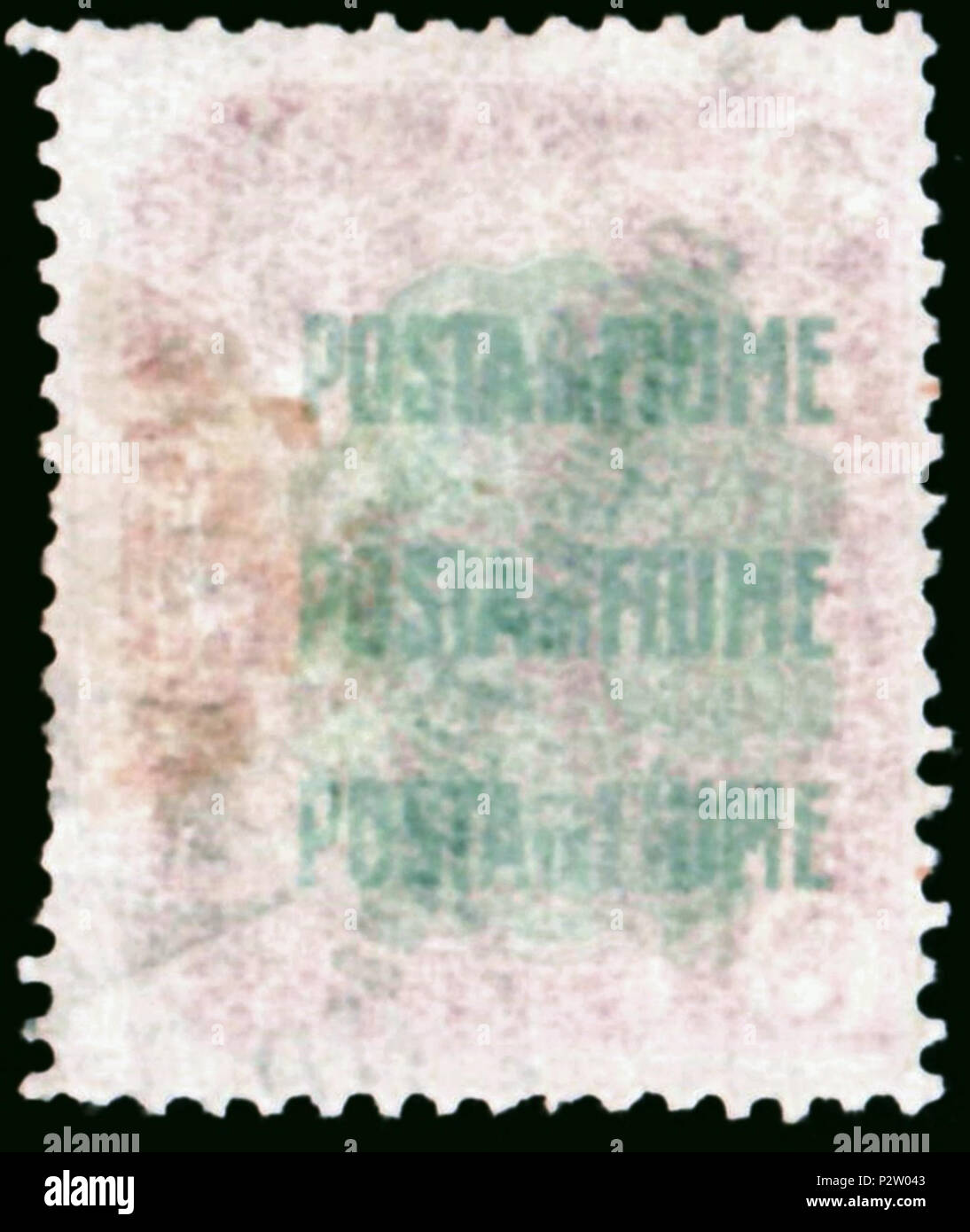 . Backside of a stamp of Fiume; 1922 (original from 1919); visualization of the protective backside print of the 1919 issue '30th October', manufactured by the printery 'Bertieri & Vanzetti, Milano'; print in very dull bluegreen with threefold inscription 'POSTA di FIUME' (one below the other) on very dull decorative pattern of an underpress of the same color. This protective print exist only in the original issue (Michel No. 50 - 61), printed by Bertieri & Vanzetti. It's lacking at reprints, but present at the stamps used for later overprint variants. 12 April 1922, overprint on front side on - Stock Image