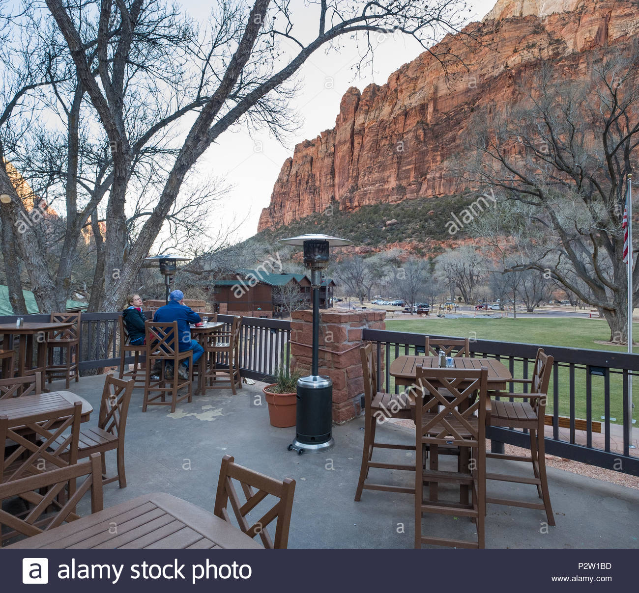 People sitting at tables on outside the Red Rock Grill, Zion National Park Lodge, Zion National Park, Washington County, Utah, USA - Stock Image