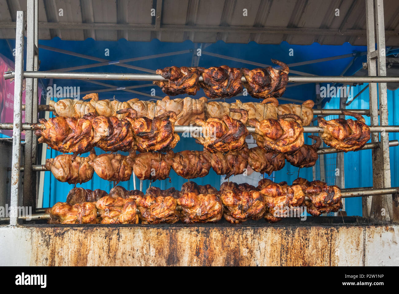 Roasted chicken marvelous selling in Ramadan bazaar. - Stock Image