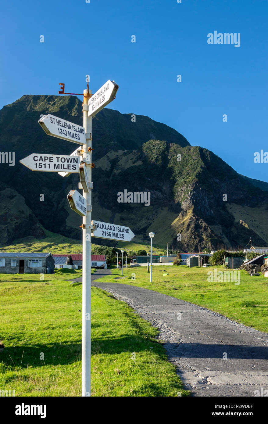 Signpost with distances to the nearest islands and cities at Tristan da Cunha, British Overseas Territories, South Atlantic Ocean - Stock Image