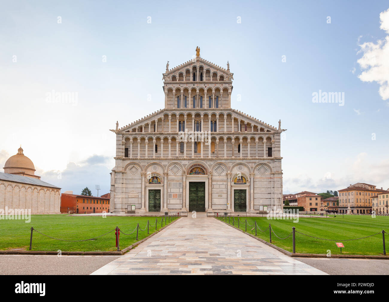 Pisan Romanesque facade of medieval Roman Catholic Pisa Cathedral at Piazza dei Miracoli (Square of Miracles) or Piazza del Duomo (Cathedral Square),  - Stock Image