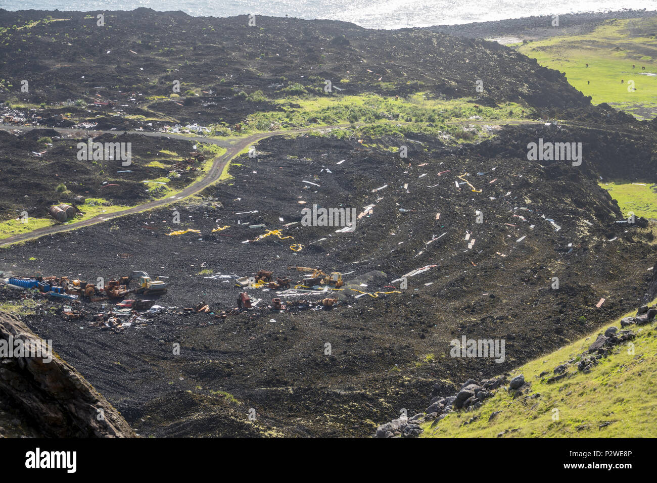 View over the remains of the old fish factory destroyed in the 1961 eruption at Tristan da Cunha, British Overseas Territories, South Atlantic Ocean - Stock Image