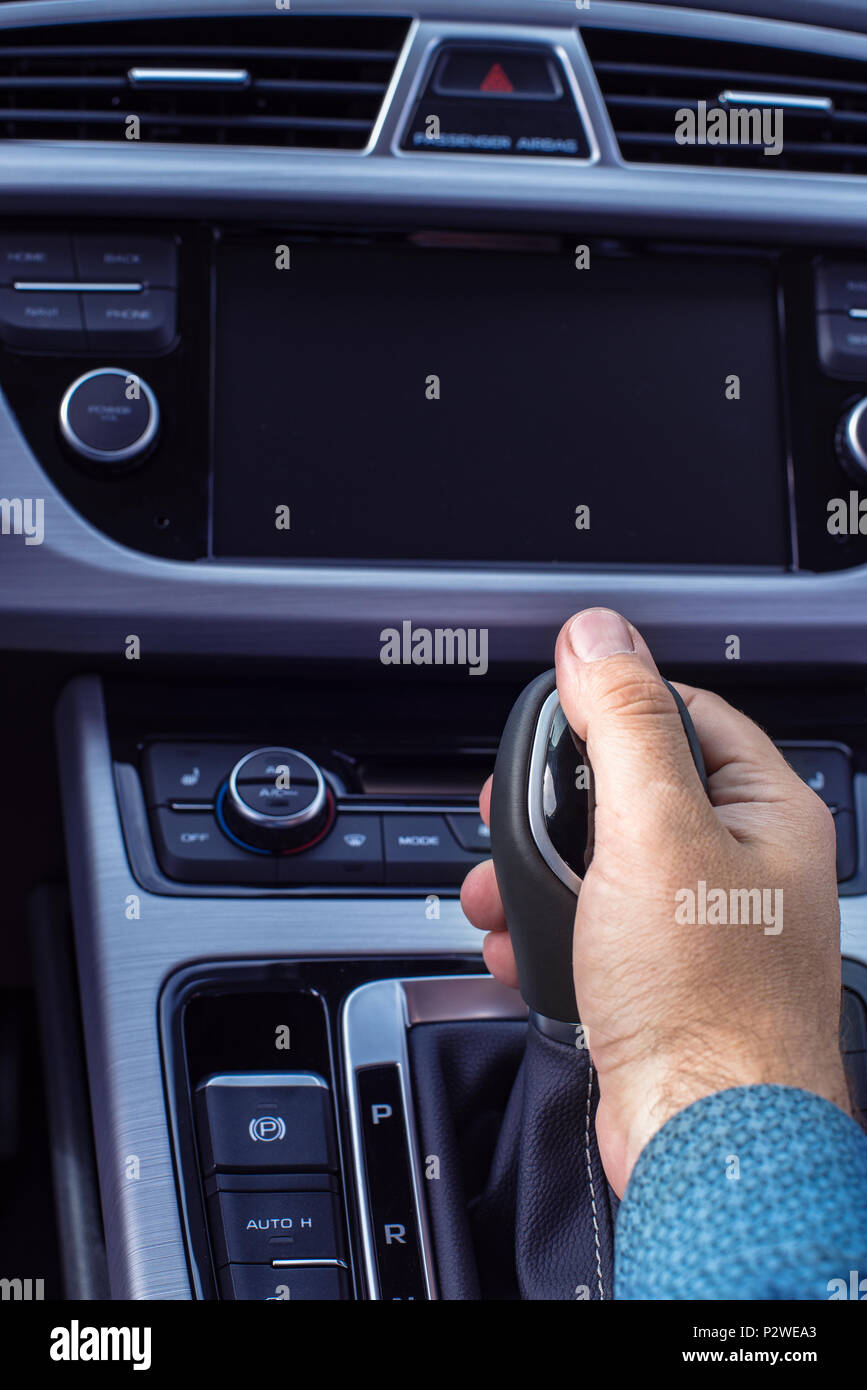 hand on the gearshift lever - Stock Image