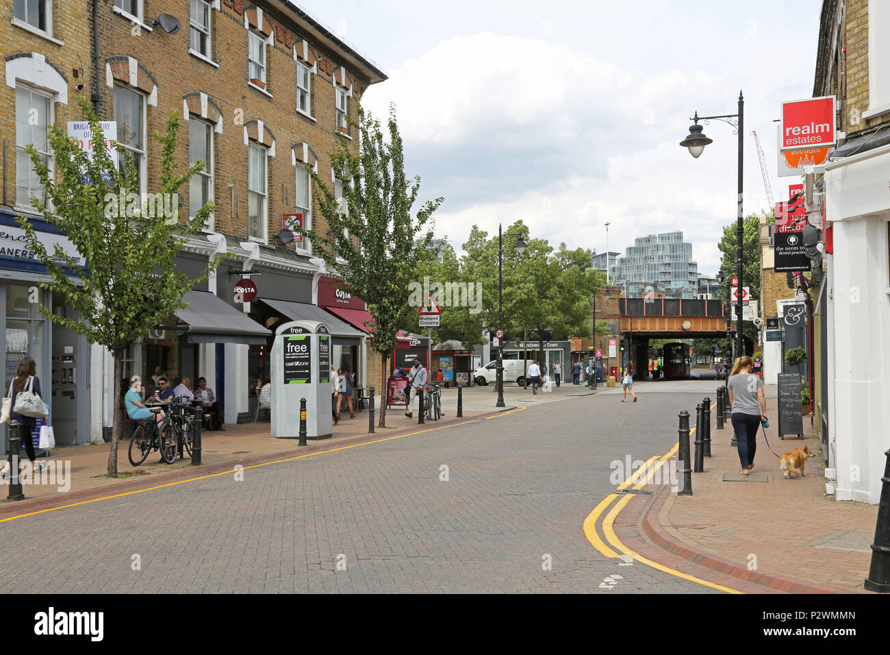Local shops and cafes close to Wandsworth Town rail station, a fashionable area of southwest London, UK. Shows effective parking controls. - Stock Image