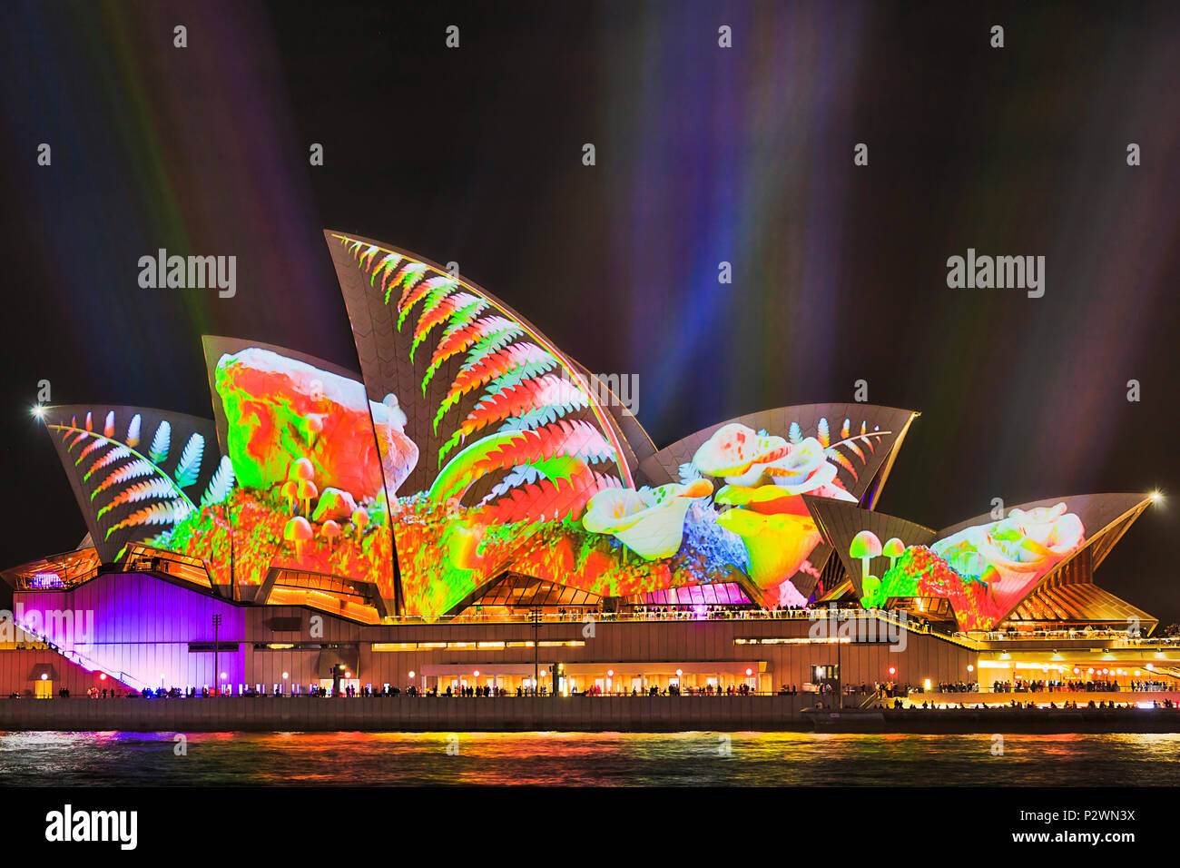 Sydney, Australia - 25 May, 2018: Sydney city landmark of Sydney Opera House at harbour waterfront during annual light show of light and ideas in brig - Stock Image