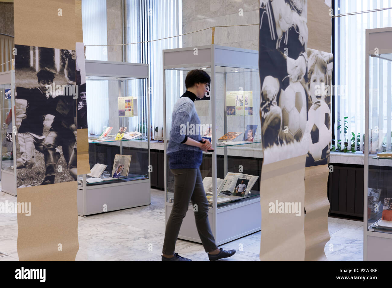 St. Petersburg, Russia - June 7, 2018: Visitor of the exhibition 'Goal!!! FIFA World Cups history' in the National Library of Russia. The exhibition i - Stock Image