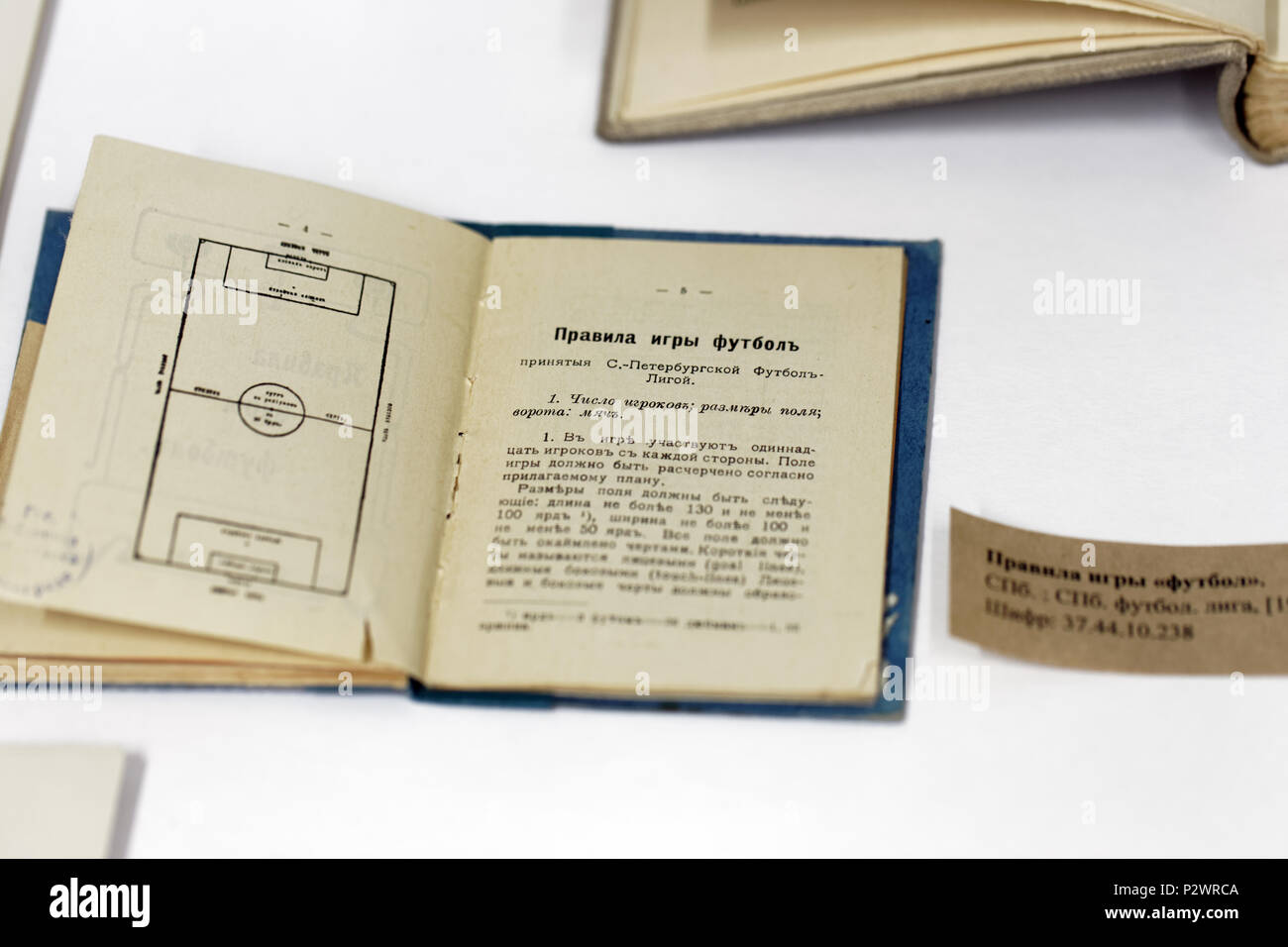 St. Petersburg, Russia - June 7, 2018: Football game rules issued in 1911 on the exhibition 'Goal!!! FIFA World Cups history' in the National Library  - Stock Image