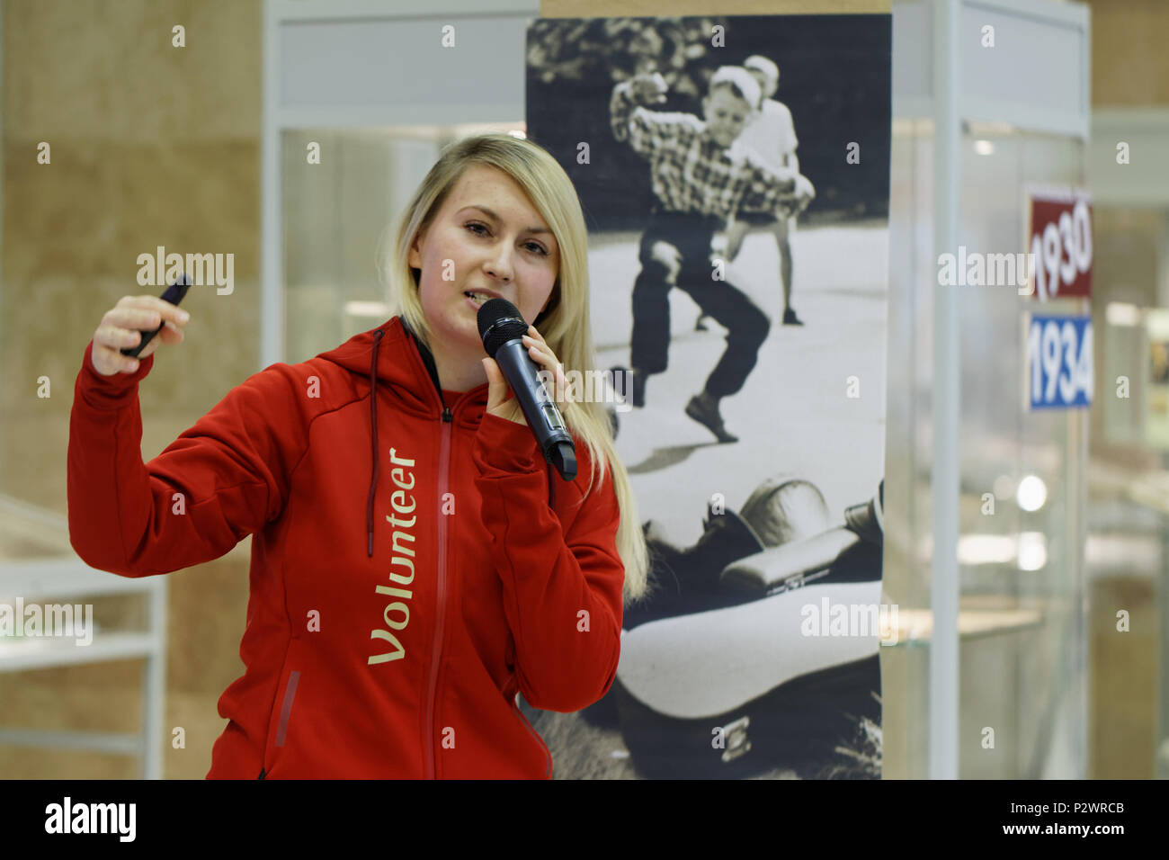 St. Petersburg, Russia - June 7, 2018: Volunteer of FIFA World Cup 2018 Elizaveta Usmanova on the opening of exhibition 'Goal!!! FIFA World Cups histo - Stock Image