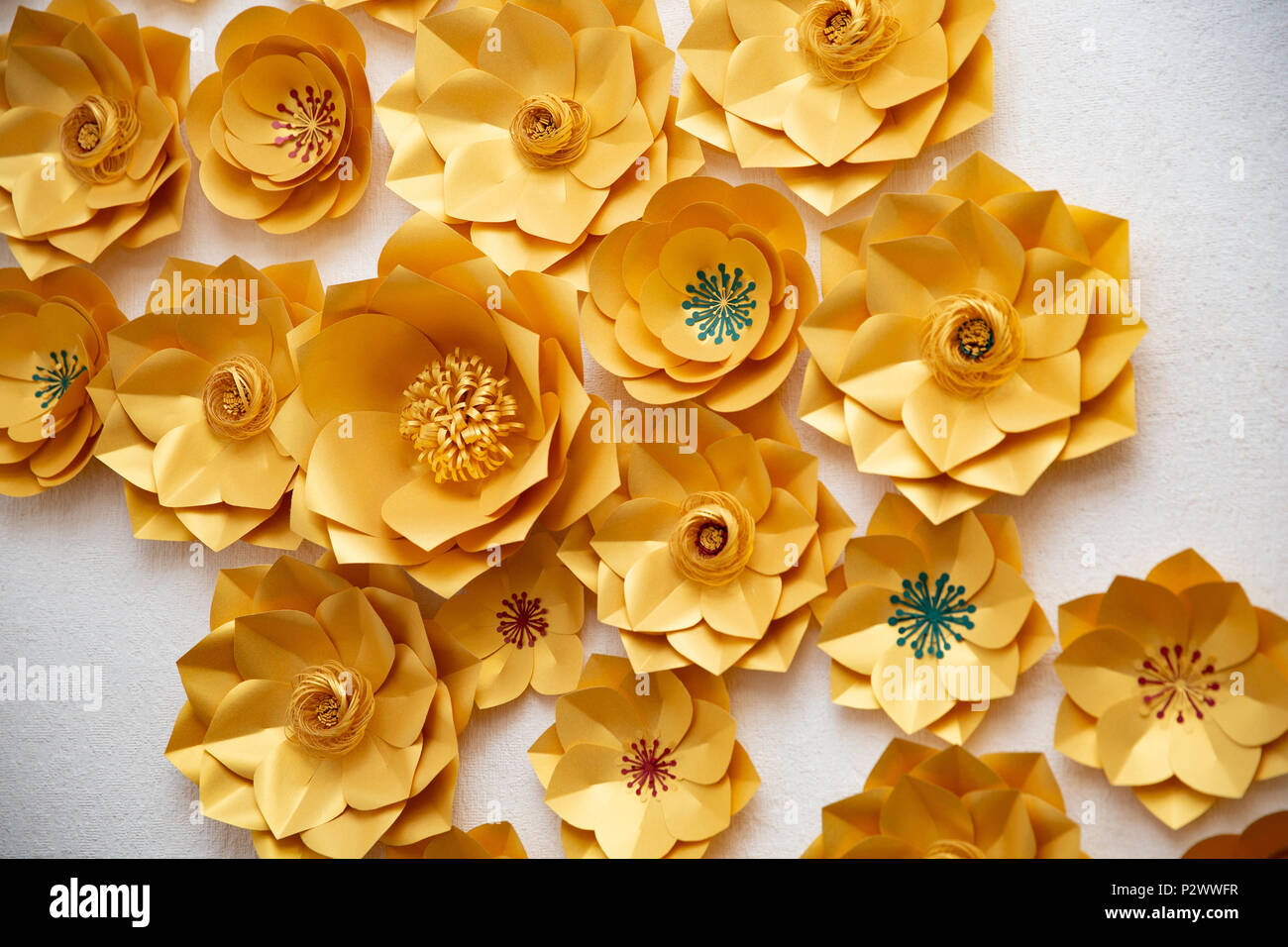 Floral Arrangement Of Yellow Paper Flowers On A White Backgrounde