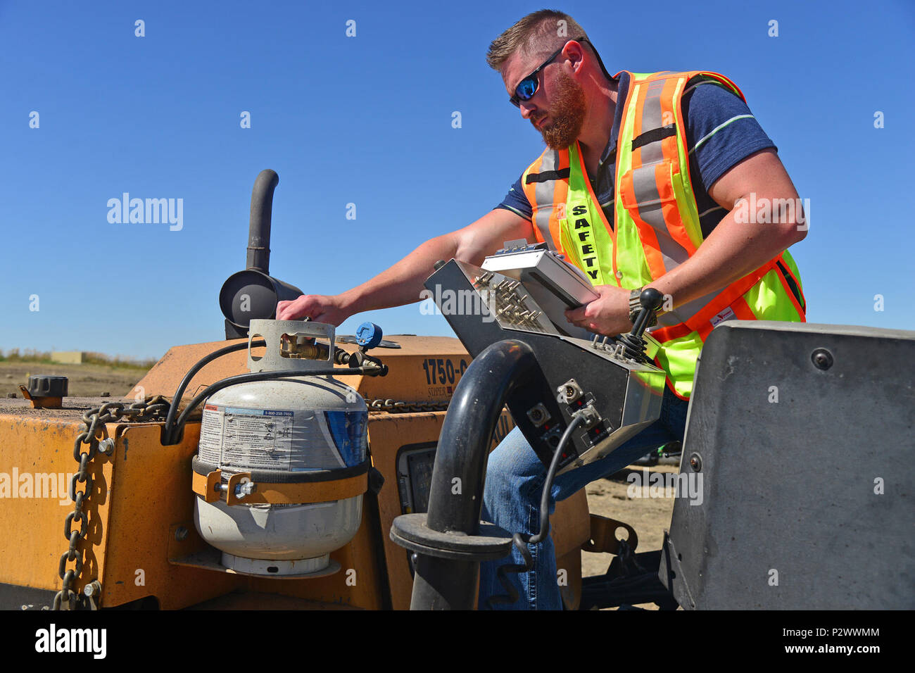 Jason Webb, 341st Missile Wing occupational safety and health specialist, inspects a propane tank Aug. 1, 2016, at Malmstrom Air Force Base, Mont. The safety office performs random spot inspections focusing on identifying preventable workplace hazards that could potentially cause injury or death to a member. (U.S. Air Force photo/Airman 1st Class Daniel Brosam) Stock Photo