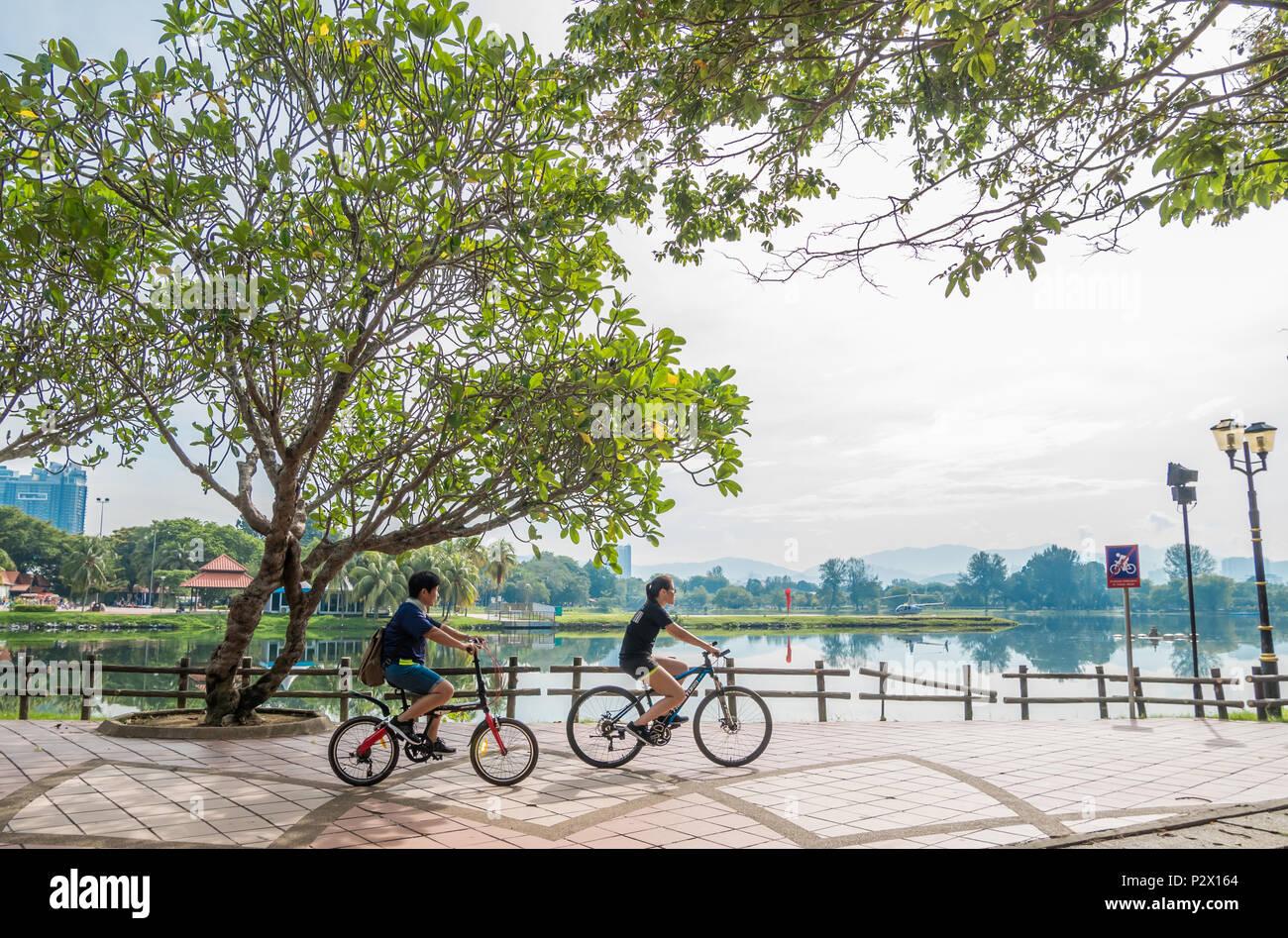 Kuala Lumpur, Malaysia - May 29,2018 : People can seen cycling bicycles to explore the beautiful of the Titiwangsa Lake Gardens in the morning. - Stock Image