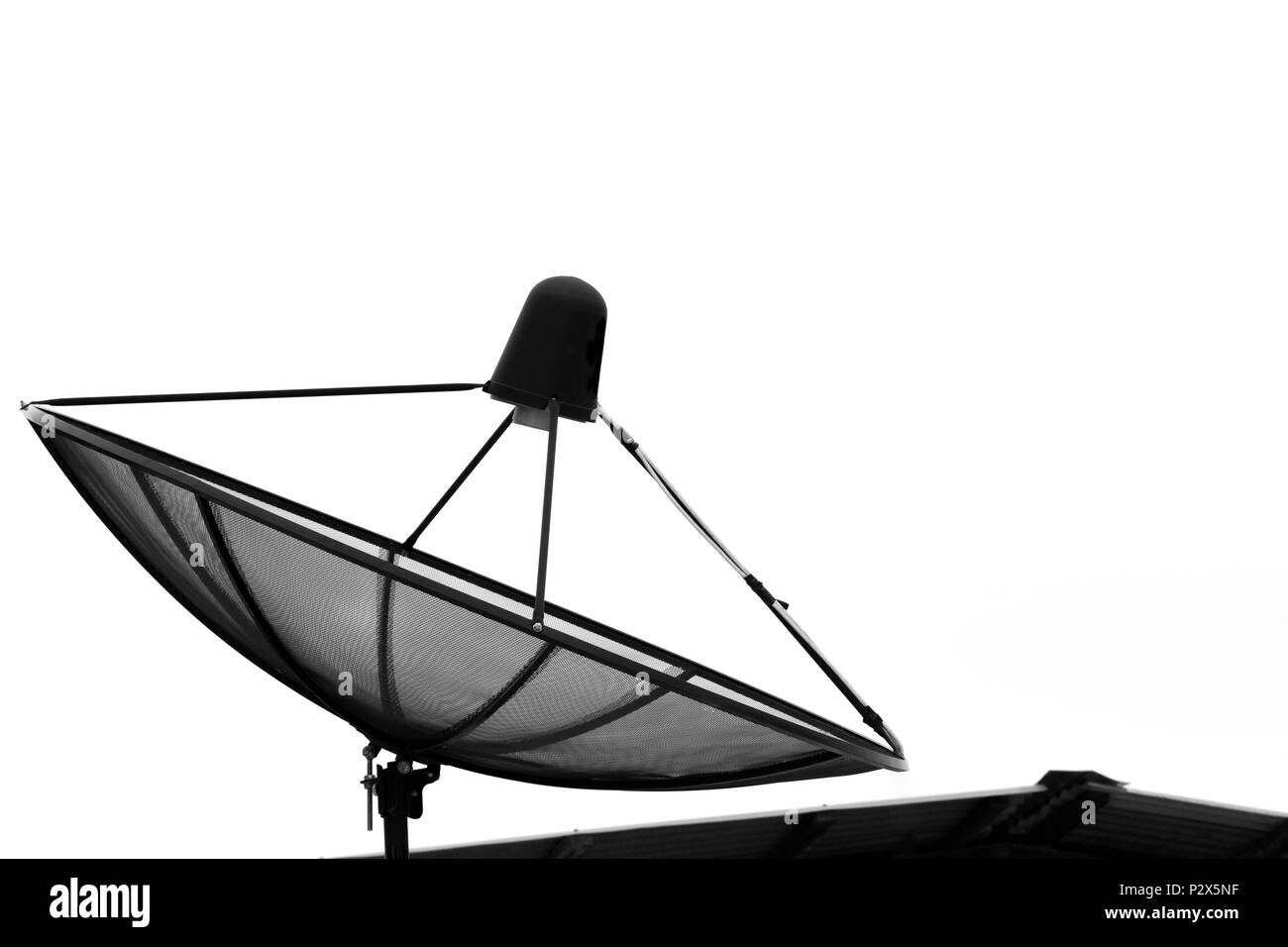 Satellite dish for communication broadcast on roof with white background. - Stock Image