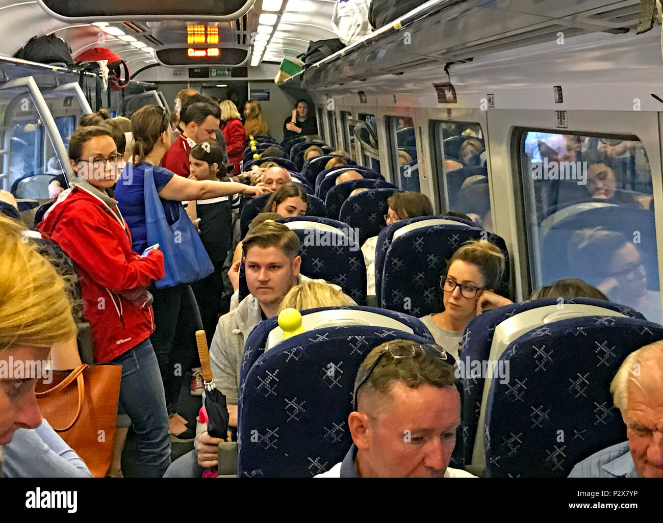 Busy, Overcrowded Scotrail Class 158 train on borders railway Edinburgh to Tweedbank - Stock Image
