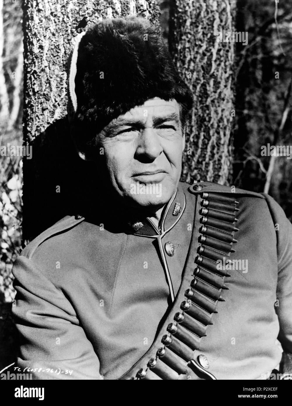 Original Film Title: THE CANADIANS.  English Title: THE CANADIANS.  Film Director: BURT KENNEDY.  Year: 1961.  Stars: ROBERT RYAN. Credit: 20TH CENTURY FOX / Album - Stock Image