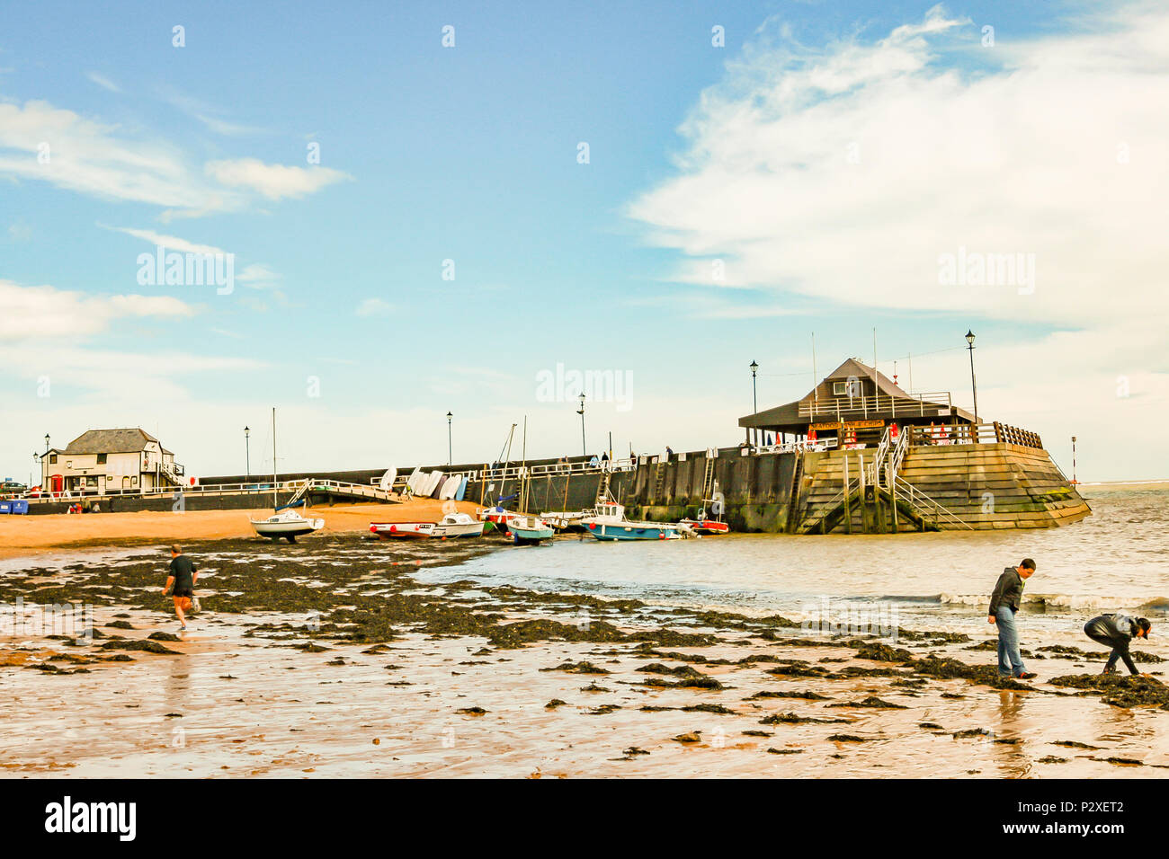 boys having fun on the water's edge on the beach at viking bay, broadstairs, kent, england Stock Photo