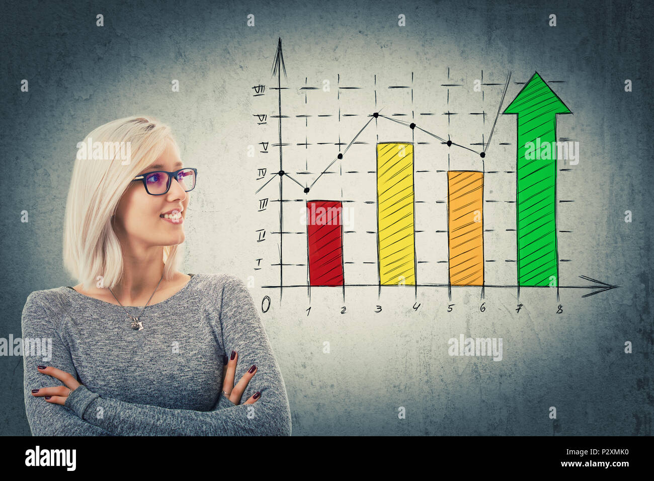 Close up portrait of young woman with crossed arms, wearing glasses looking at a rising graph. Business profit, growth and progress symbol on colorful - Stock Image