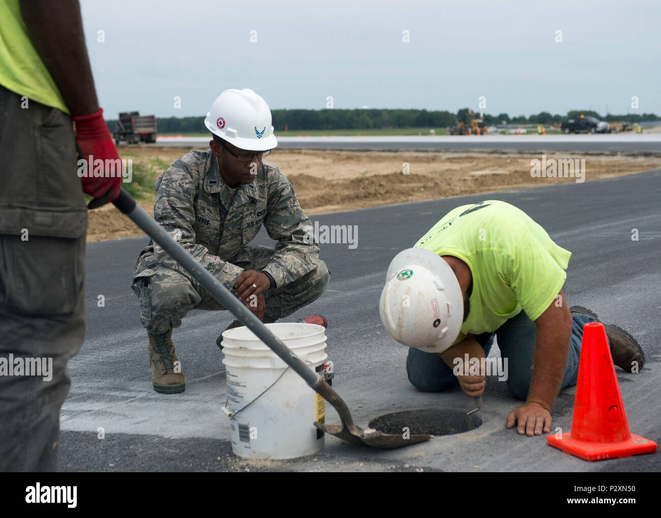 1st Lt. Prince Chavis, civil engineer officer with the 822nd Civil Engineer Flight, observes contractors working on a runway's instrument controlled landing system Aug. 8, 2016, Dover Air Force Base, Del.  Instrument controlled landing systems are often used when aircraft land in inclement weather situations. - Stock Image