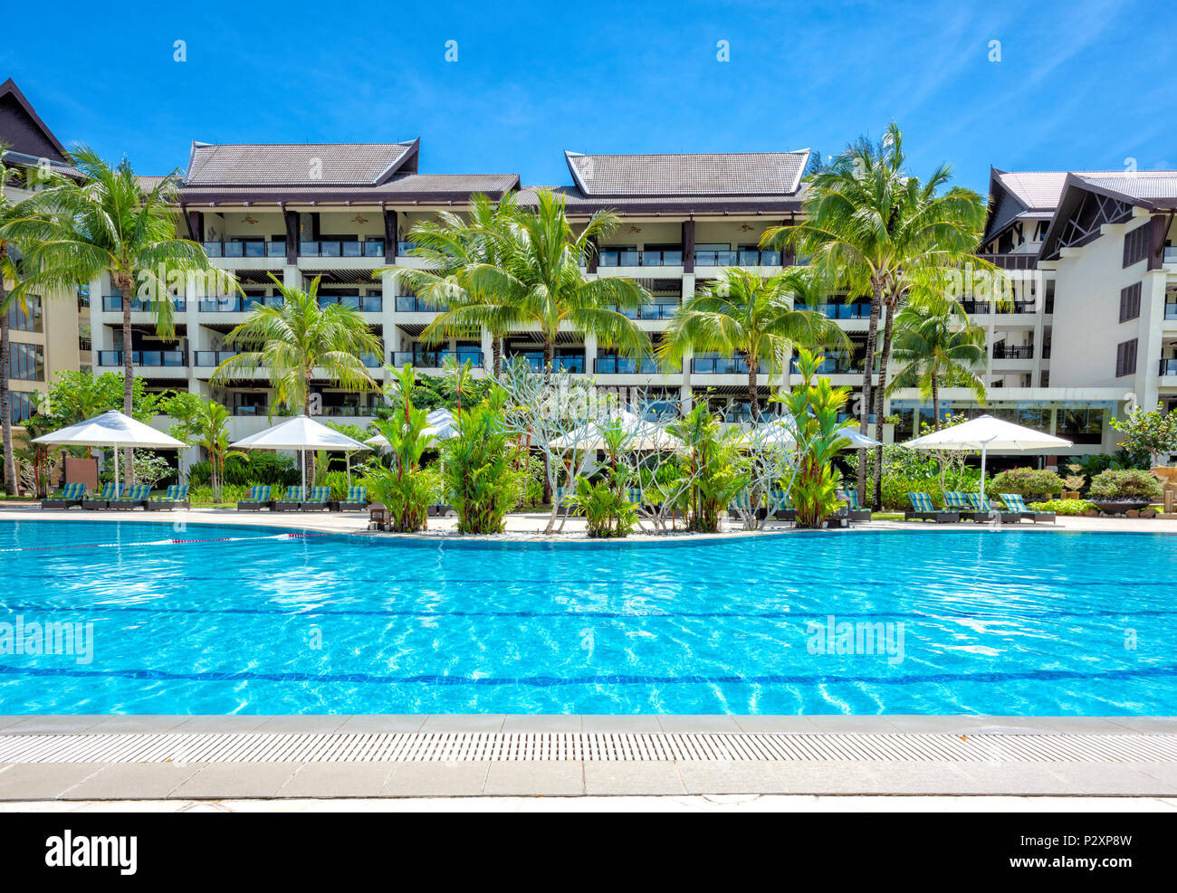 Empty outdoor swimming pool at the Shangri La Rasa Ria Hotel and Resort in Kota Kinabalu, Borneo, Malaysia Stock Photo