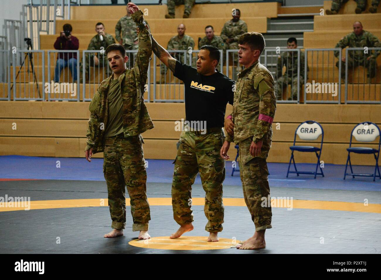 GRAFENWOEHR, Germany -- 2nd Lt. Justin Ganzer (left) of the 21st Theater Sustainment Command wins in the officer's combatives tournament Aug. 11 during the 2016 European Best Warrior Competition held at the 7th Army Training Command's Grafenwoehr Training Area. The intense, grueling annual weeklong competition is the most prestigious competitive event of the region. (U.S. Army Photo by Pfc. Emily Houdershieldt) - Stock Image