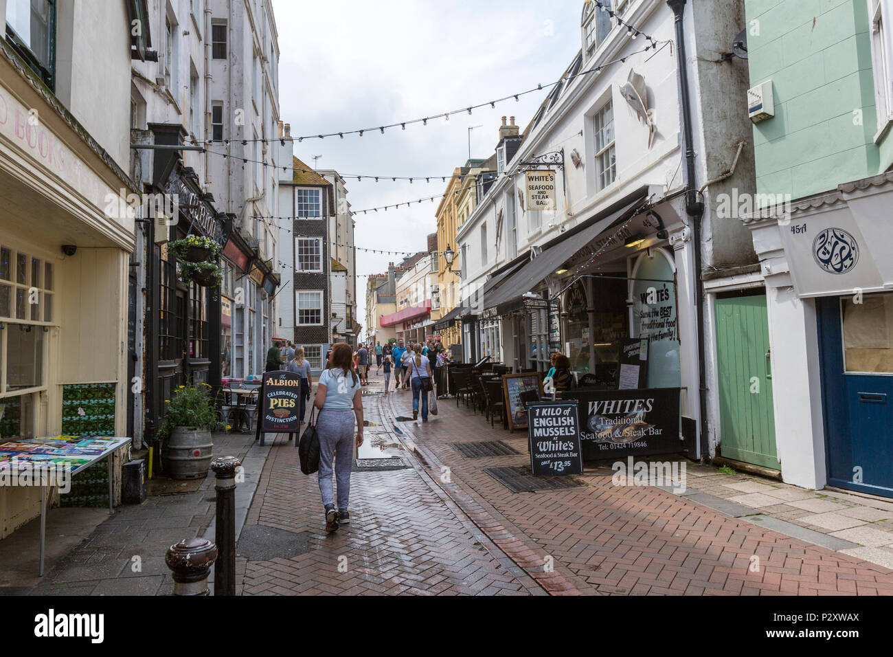 People walking along George street at Hastings old town, East Sussex, England , UK - Stock Image