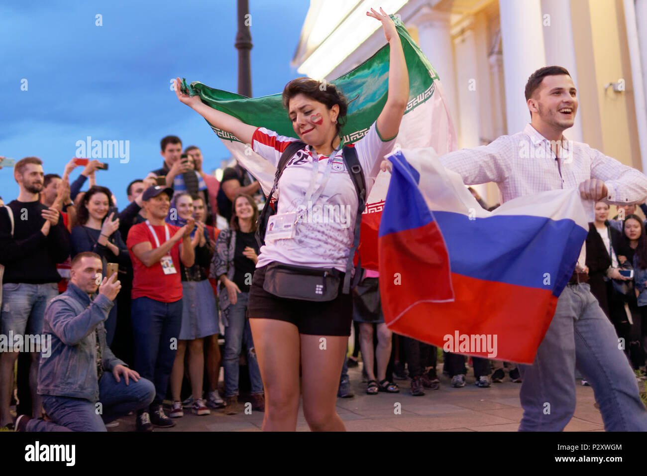 St. Petersburg, Russia - June 15, 2018: Iranian football fans dancing on Nevsky avenue in Saint Petersburg on the day of first match of FIFA World Cup - Stock Image