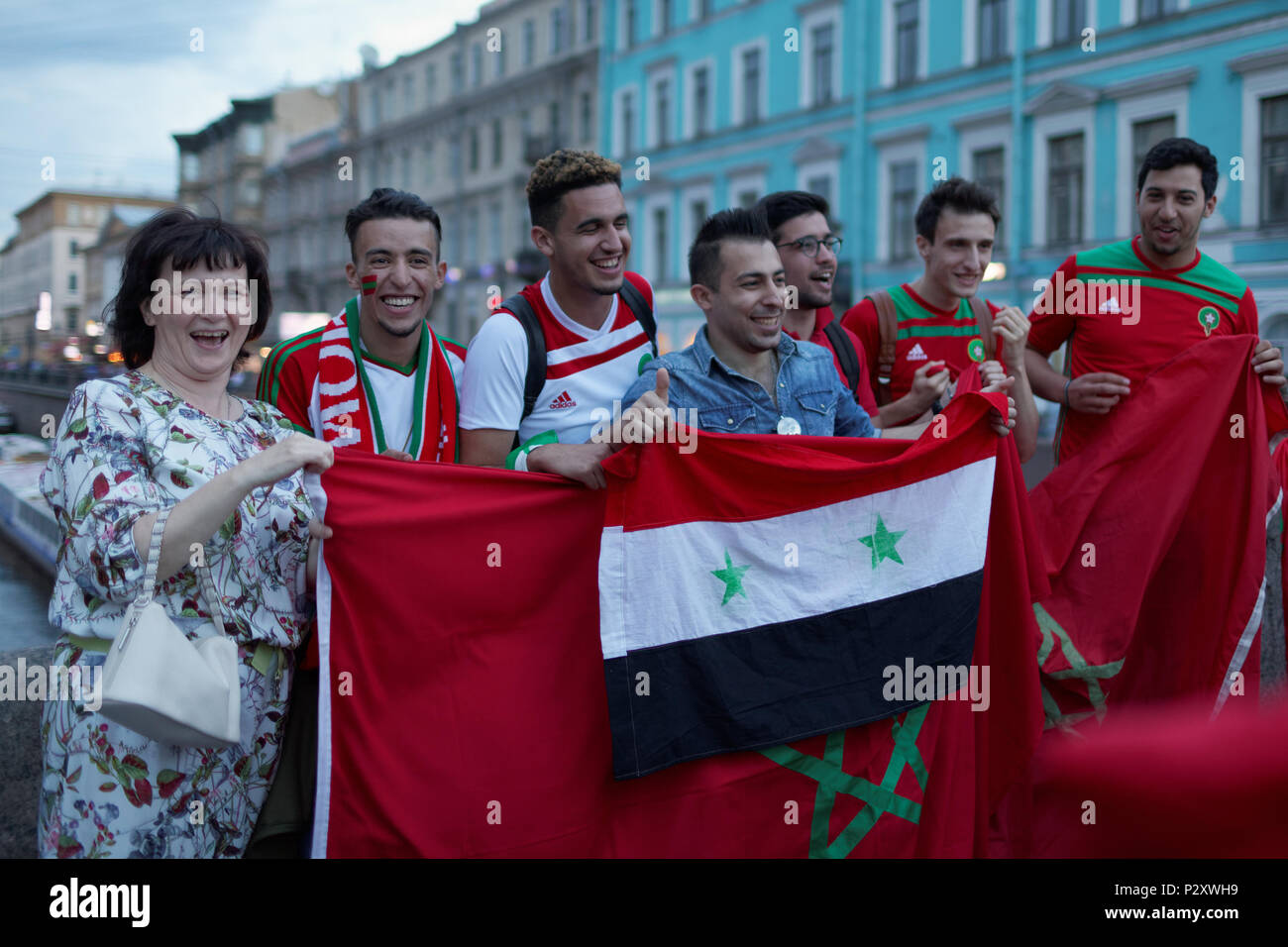 St. Petersburg, Russia - June 15, 2018: Moroccan football fans with flag in Saint Petersburg on the day of first match of FIFA World Cup 2018 in the c - Stock Image