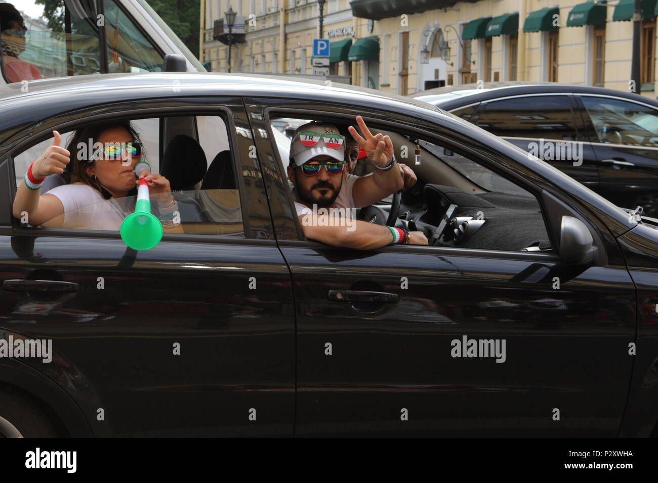 St. Petersburg, Russia - June 15, 2018: Iranian football fans with attributes in a car in Saint Petersburg on the day of first match of FIFA World Cup - Stock Image