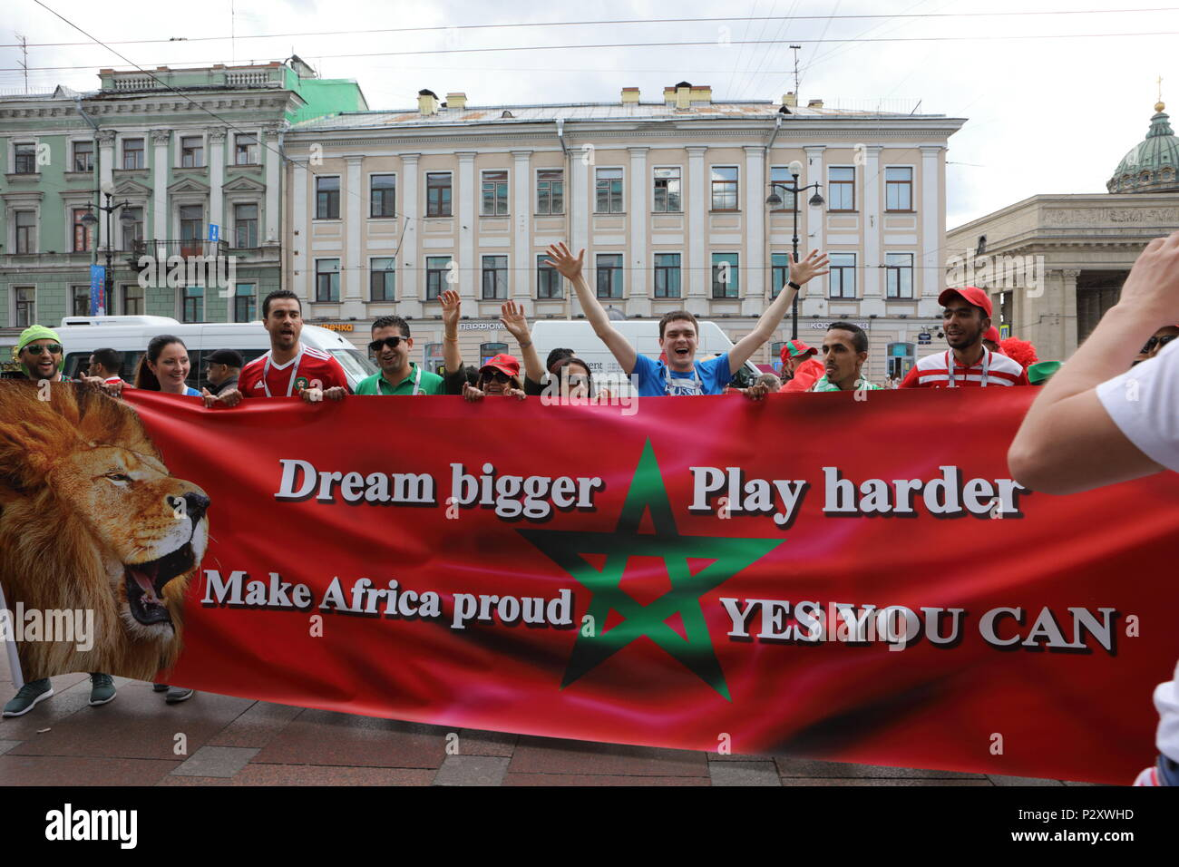 St. Petersburg, Russia - June 15, 2018: Moroccan football fans with a banner in Saint Petersburg on the day of first match of FIFA World Cup 2018 in t - Stock Image