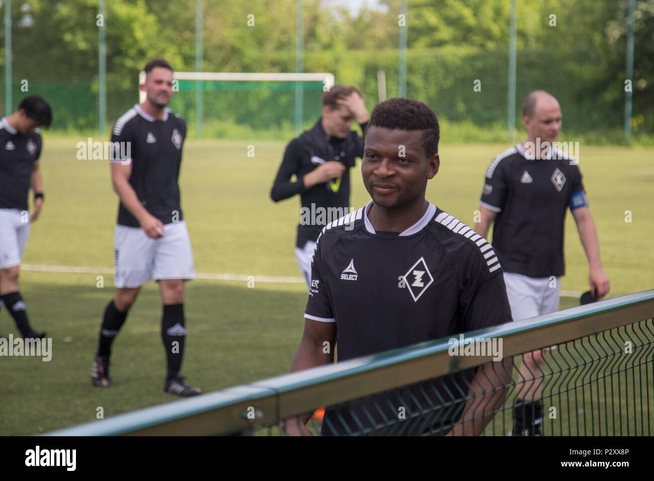 Saheed Olakunle Adeshina, player of local football club AKS Zly after a game - Stock Image