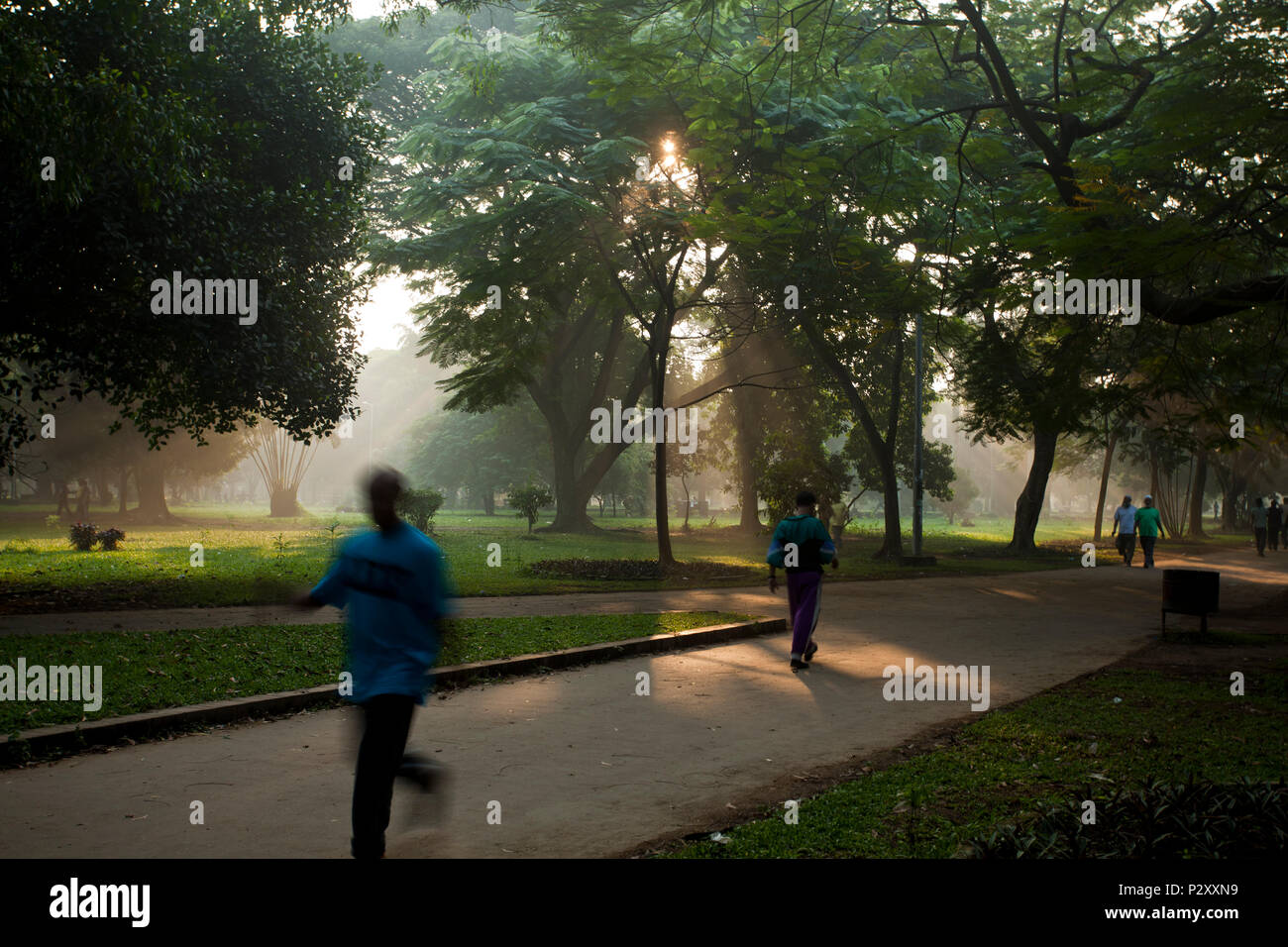 City dwellers take a morning walk in the wintry weather in the Ramna Park in Dhaka, Bangladesh - Stock Image