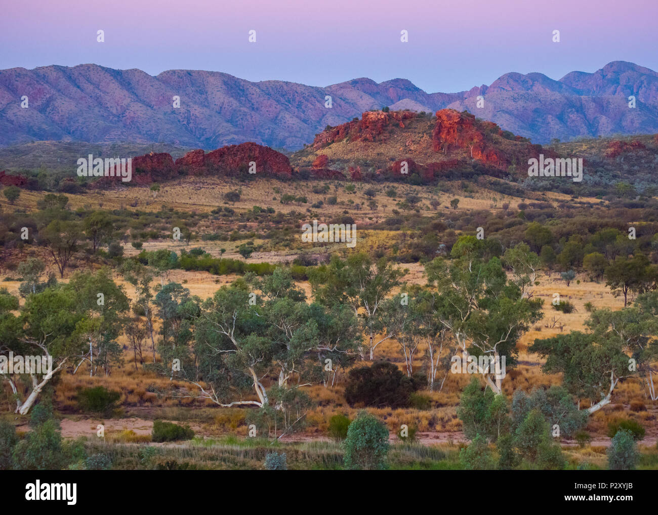 Twilight in Australia's West Macdonnell Ranges, which is a popular destination for tourists and Australian residents alike. - Stock Image