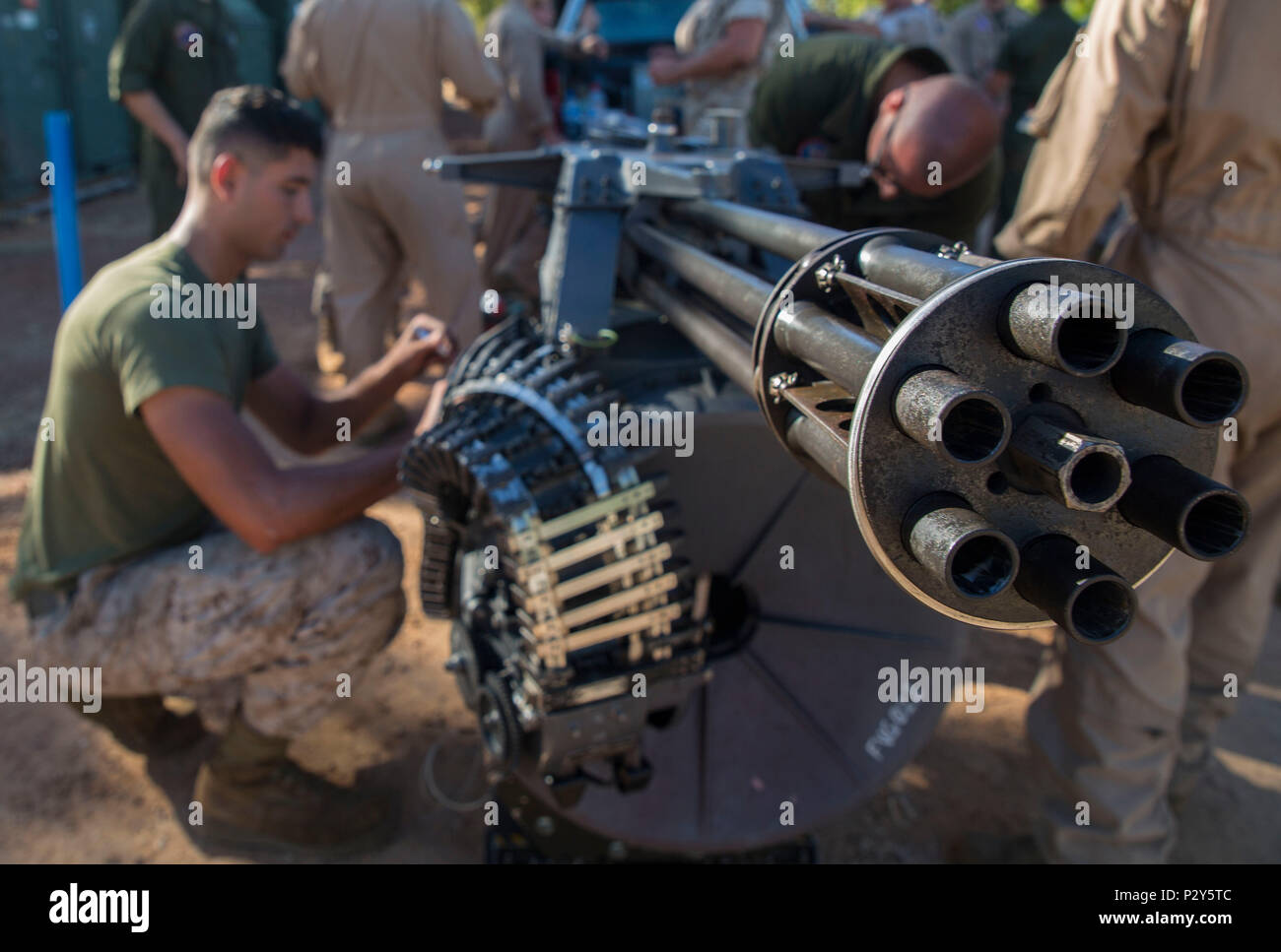 U.S. Marines with Marine Fighter Attack Squadron (VMFA) 122 perform maintenance on an M61A2 20mm Vulcan cannon during Exercise Pitch Black 2016 at Royal Australian Air Force Base Tindal, Australia, Aug. 5, 2016. The lightweight gun is used only in F/A-18s and the six rotating barrels minimize barrel erosion and heat generation, contributing to a long weapon life. Shooting 6,000 rounds per minute, the gun will replace a cannon in one of the squadron's F/A-18C Hornets and will be used for ground targets during Pitch Black. The exercise affords Marines with VMFA-122 the opportunity to integrate a - Stock Image