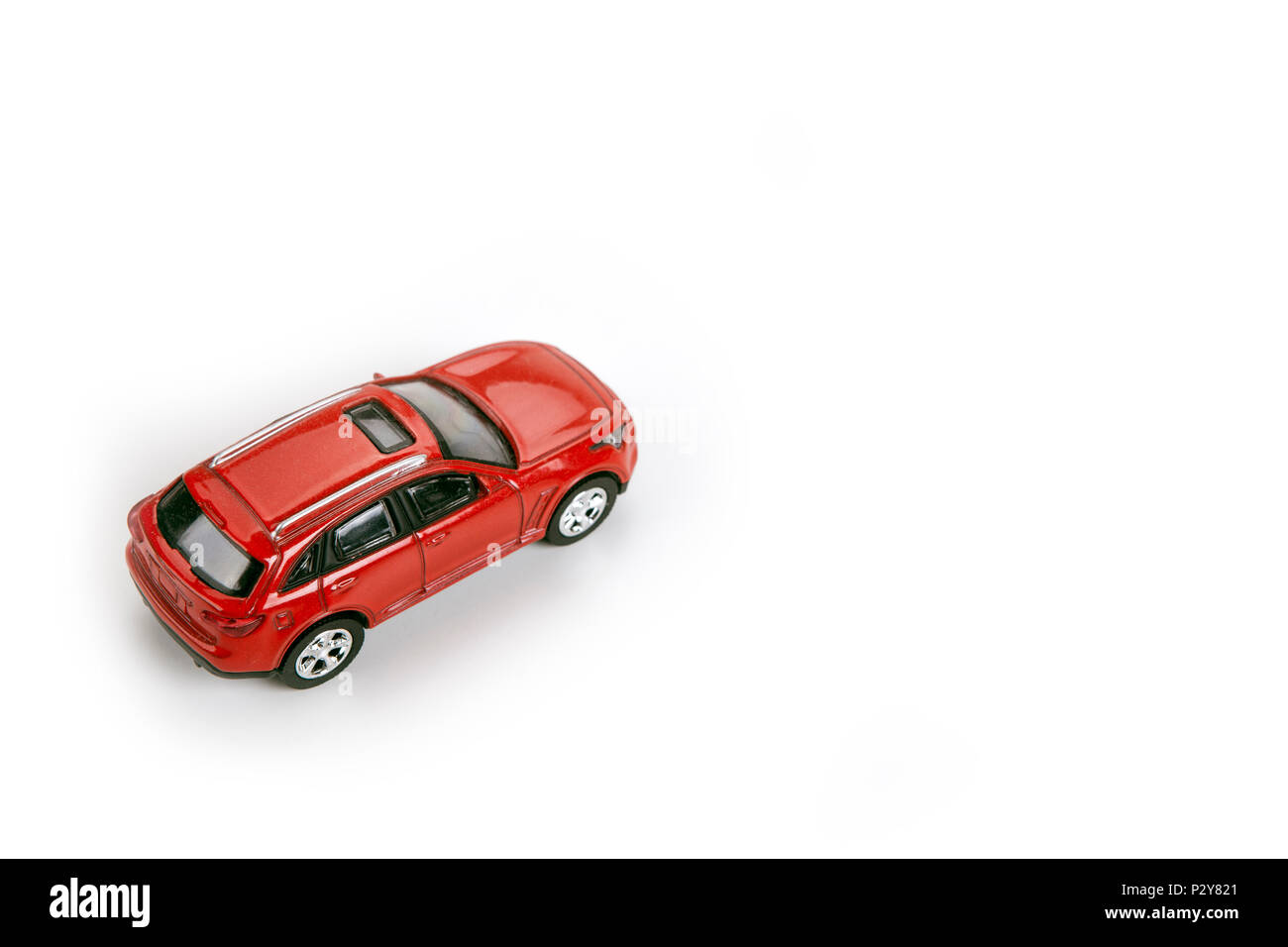 red car model on a white background closeup - Stock Image
