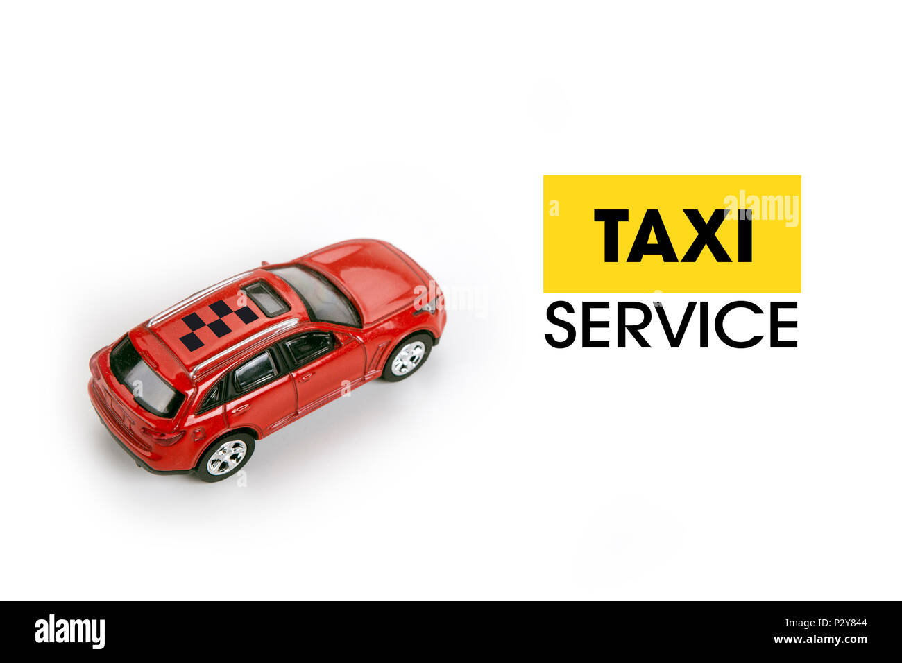 red car model on a white in the concept of calling a taxi - Stock Image