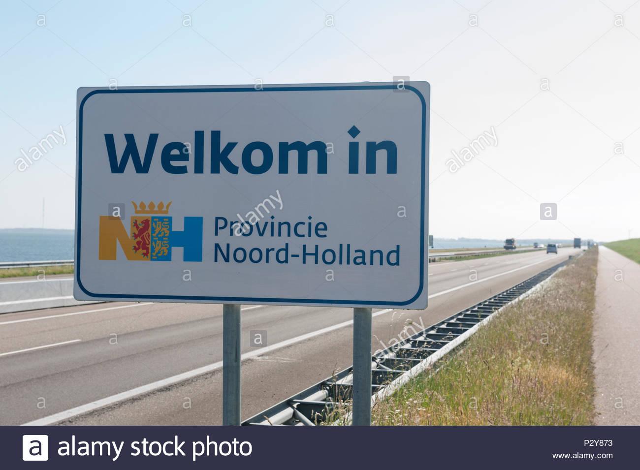 Afsluitdijk The Netherlands A7 motorway along the Afluitdijk, sign Welkom in Noord Holland. - Stock Image