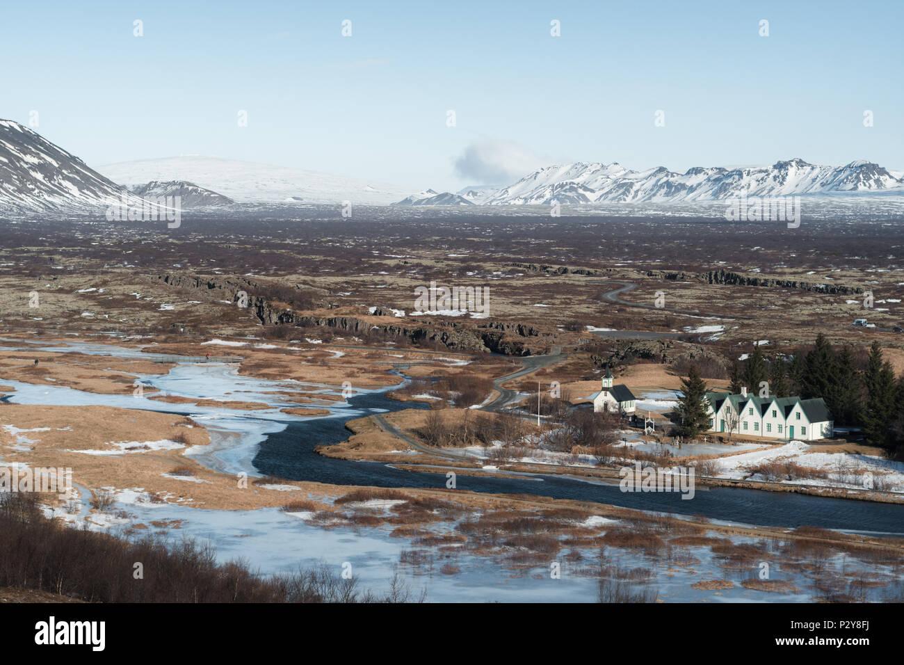 Wide shot of Þingvellir National Park on a clear sunny day. Öxará River, Þingvellir church and the site of Iceland's first parliament can be seen. Stock Photo