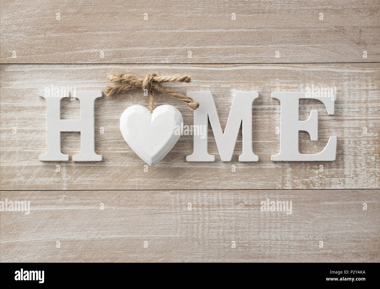 Home sweet home, wooden text on vintage board background with copy space - Stock Image