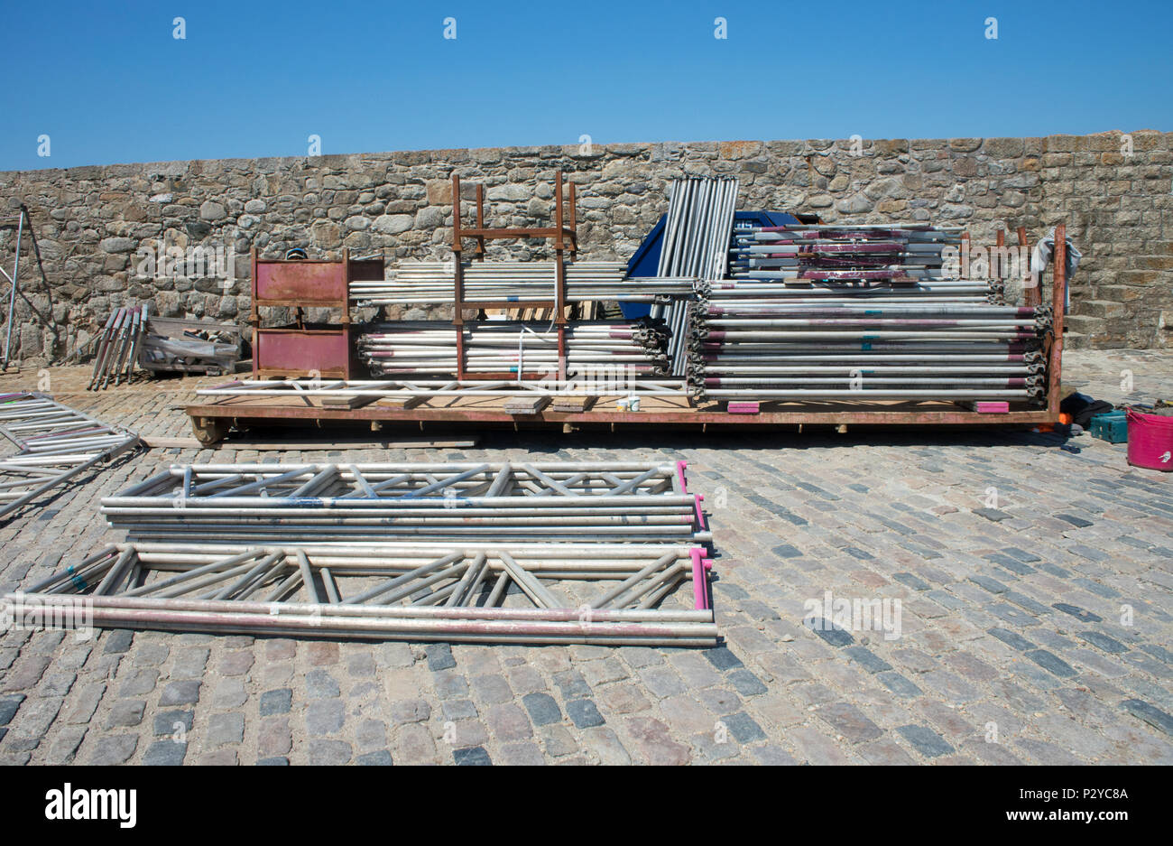 Pile of scaffolding equipment waiting to be erected - John Gollop - Stock Image